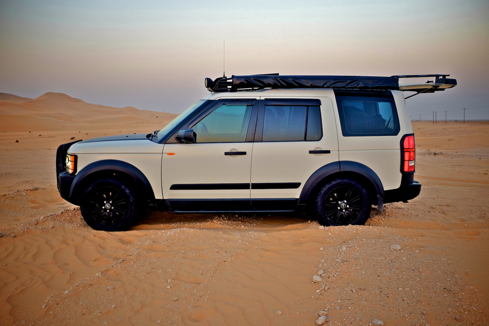 Not sure a roof-top-tent can be that sleek but there is a handy ladder to reach the roof if needed. Land Rover & Land Rover | Weekend ideas for the UAE